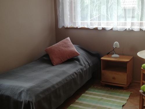 Łóżko lub łóżka w pokoju w obiekcie Pod Dobrym Aniołem