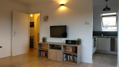 A television and/or entertainment center at Seaside Apartment