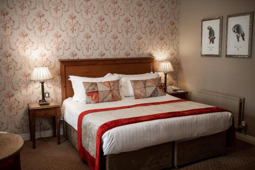 A bed or beds in a room at Clanard Court Hotel