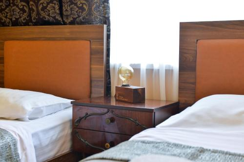 A bed or beds in a room at Friendly Guest House