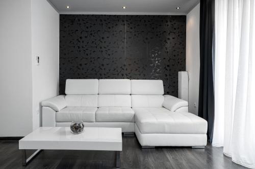 The Suites - Small Luxury Livingにあるシーティングエリア