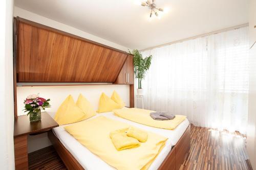 Ein Bett oder Betten in einem Zimmer der Unterkunft Easyapartments Central Business
