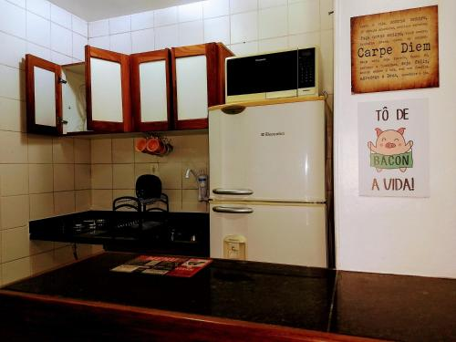 A kitchen or kitchenette at Flat Barra