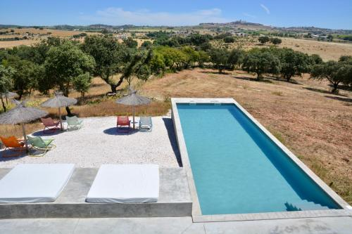 A view of the pool at Casa Azimute or nearby