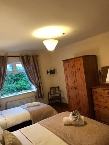 A bed or beds in a room at The Ring Lyne