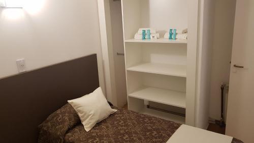 Una cama o camas en una habitación de Bagu Playa Grande Hotel