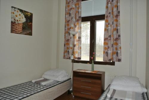 Кровать или кровати в номере Lakehouse Saimaa B&B