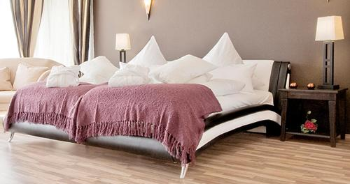 A bed or beds in a room at MaraVilla Beauty & Spa