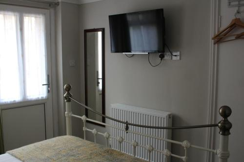 A television and/or entertainment center at Fernleigh Guest House