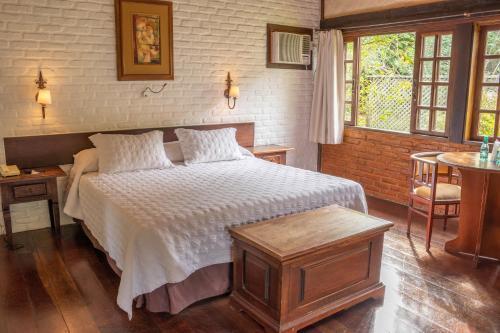 Cama ou camas em um quarto em Bomtempo Hotel Esporte & Lazer
