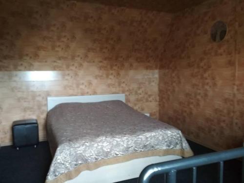 Кровать или кровати в номере Гостевой дом Сказка