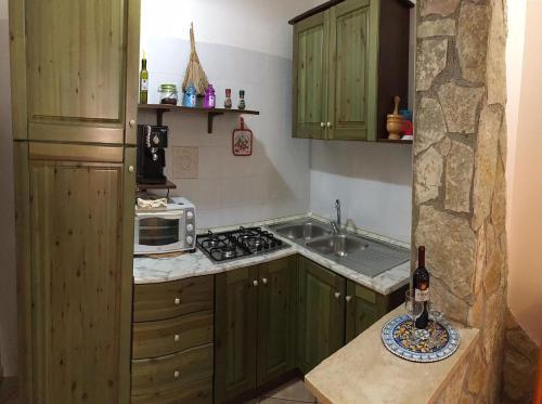 A kitchen or kitchenette at Appartamenti Monacò