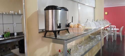 A kitchen or kitchenette at Vitória Center Plaza