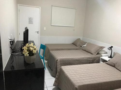 A bed or beds in a room at Suites Residence
