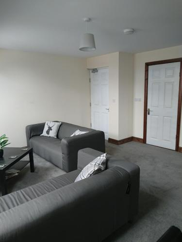 A seating area at 2 Wood Yard Cottages, Red Mayes Farm