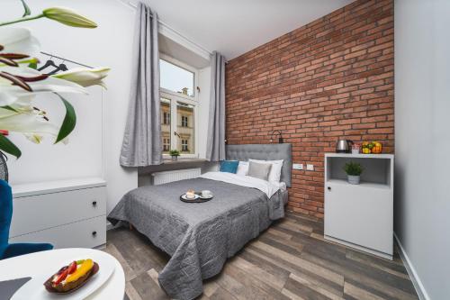 Posteľ alebo postele v izbe v ubytovaní Liv Apartments Old Town