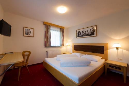 Ein Bett oder Betten in einem Zimmer der Unterkunft Hotel Bergkranz