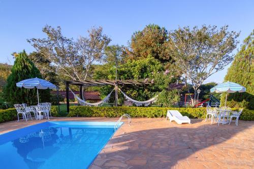 The swimming pool at or near Pousada Lua Luana