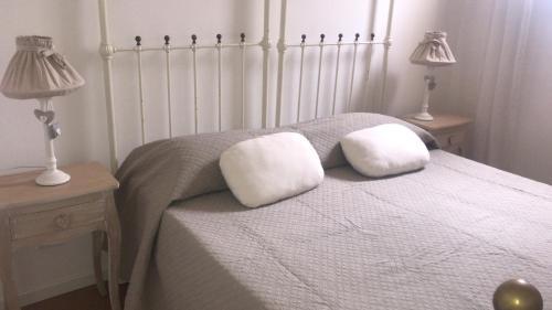 Letto o letti in una camera di Casa Le Volte