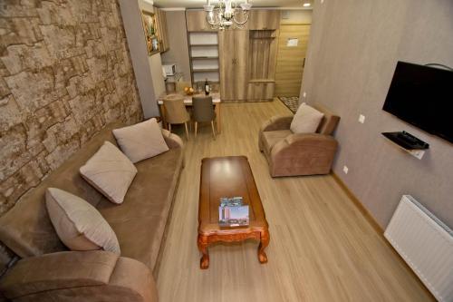 A seating area at Orbi Bakuriani apartment 731
