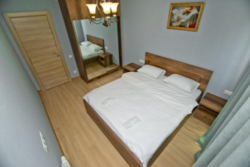 A bed or beds in a room at Orbi Bakuriani apartment 729