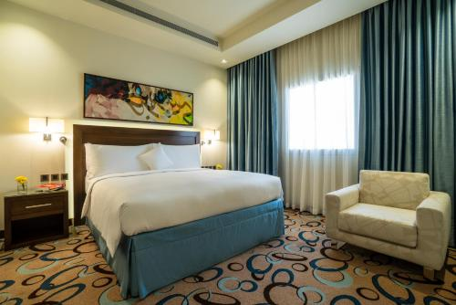 A bed or beds in a room at Marriott Executive Apartments Madinah