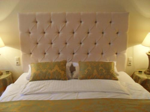A bed or beds in a room at In Piazza