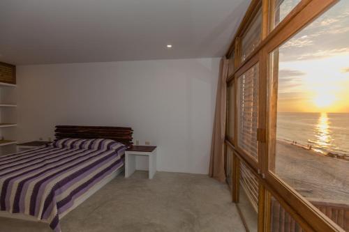 Cama o camas de una habitación en Canoas Lofts