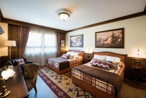 Ein Bett oder Betten in einem Zimmer der Unterkunft PortAventura® Hotel Colorado Creek - Includes PortAventura Park Tickets