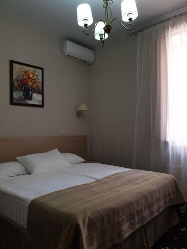 Кровать или кровати в номере Отель Афродита