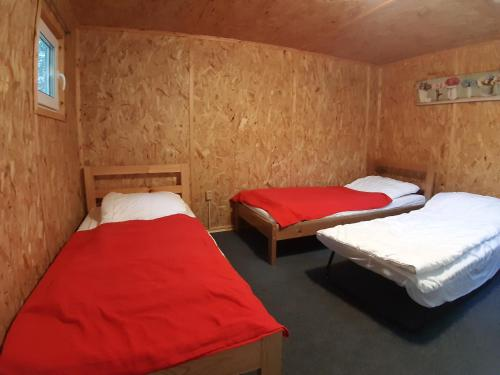 A bed or beds in a room at Svistunovo Camping