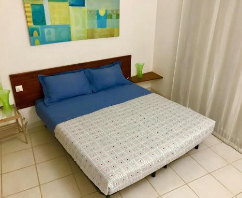 A bed or beds in a room at Villa 6 CinqueSensi ''Le Village Marin''