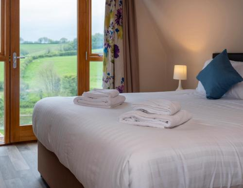 A bed or beds in a room at The Poltimore Inn