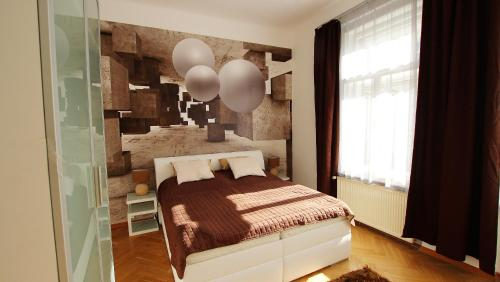 A bed or beds in a room at Taurus 2 Apartment