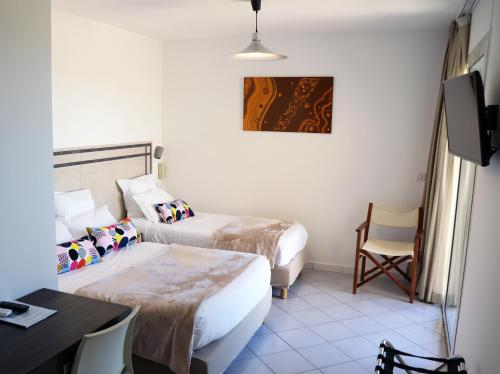 A bed or beds in a room at Hotel Stella Di Mare