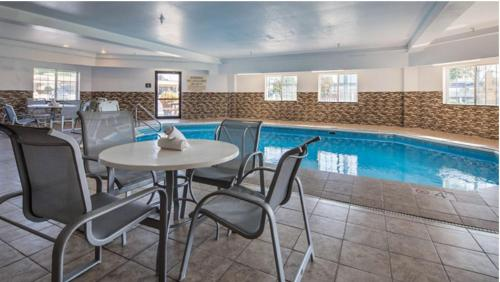 The swimming pool at or near Best Western Old Mill Inn