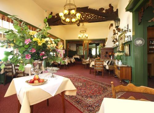Ein Restaurant oder anderes Speiselokal in der Unterkunft Uklei-Fährhaus