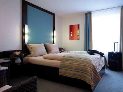 Ein Bett oder Betten in einem Zimmer der Unterkunft Hotel am Stadtring