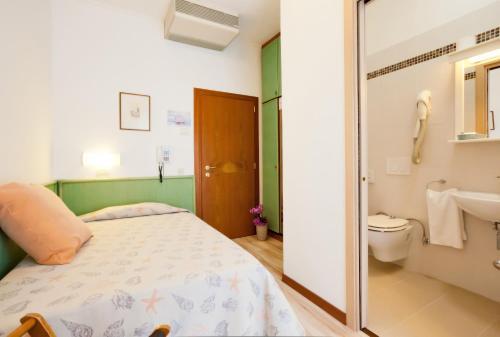 Postel nebo postele na pokoji v ubytování Hotel Excelsior
