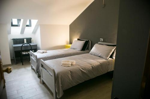 A bed or beds in a room at Lako Hostel