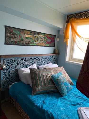Säng eller sängar i ett rum på FlipFlop Beach Bar & Rooms