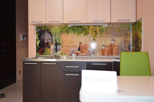 A kitchen or kitchenette at студия