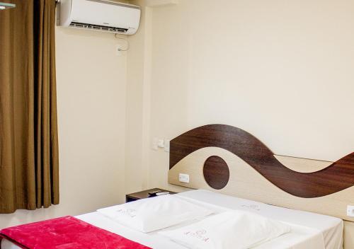 Cama ou camas em um quarto em Alkimia Hotel
