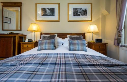 A bed or beds in a room at Goldsborough Hall