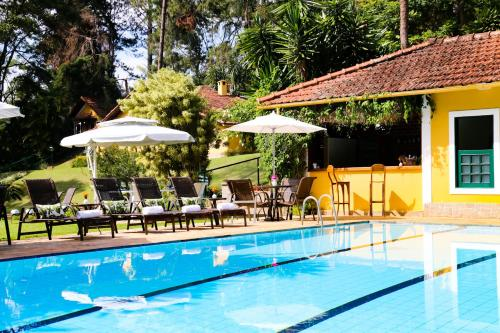 The swimming pool at or close to Hotel Capim Limão Itaipava
