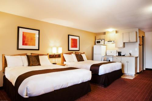 A bed or beds in a room at Coast Osoyoos Beach Hotel