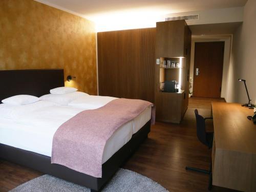 Кровать или кровати в номере Best Western Premier Hotel Rebstock