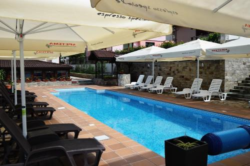 The swimming pool at or near Asya Guest House