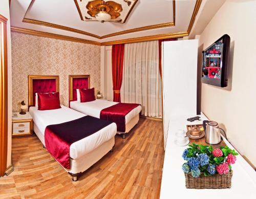 Cama o camas de una habitación en Marmara Deluxe Hotel
