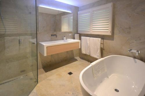 A bathroom at 131 Pacific Drive, Port Macquarie